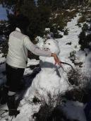 Emily building a snowman